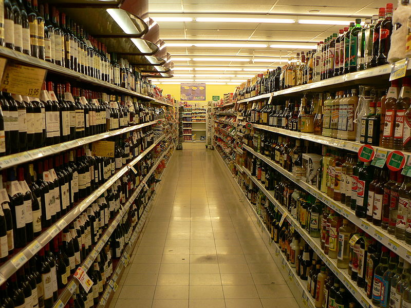 A photo of an aisle in a supermarket filled with rows and rows of products.
