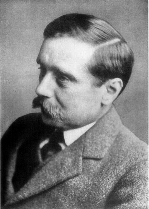 A black-and-white photo of a mustached man.
