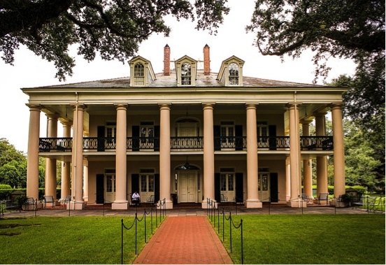 A large, stately southern plantation house.
